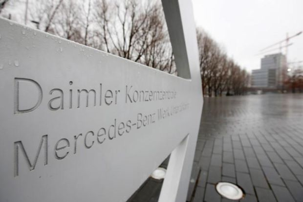 Daimler cuts dividend as Mercedes earnings take a hit from tariffs, diesel